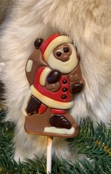 Lolly Weihnachtsmann auf Schlittschuh